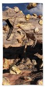 A Fossilized T. Rex Bursts To Life Beach Towel