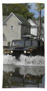 A Humvee Drives Through The Floodwaters Beach Towel