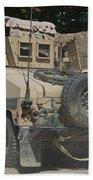 A Humvee Patrols The Streets Of Kunduz Beach Towel