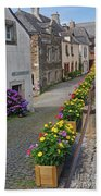 A Line Of Flowers In A French Village Beach Towel