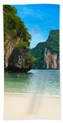 A Long Tail Boat By The Beach In Thailand  Beach Towel