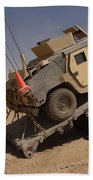 A M1114 Armored Vehicle Is Unloaded Beach Towel