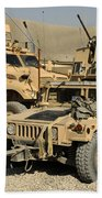 A M1114 Humvee Sits Parked In Front Beach Towel