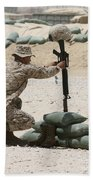 A Marine Hangs Dog Tags On The Rifle Beach Towel