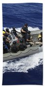 A Rigid-hull Inflatable Boat Carrying Beach Towel by Stocktrek Images