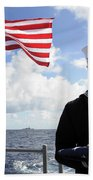 A Sailor Carries The National Ensign Beach Towel