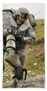 A Soldier Transports A Fellow Wounded Beach Towel