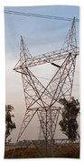 A Transmission Tower Carrying Electric Lines In The Countryside Beach Towel