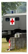 A Unimog In An Ambulance Version In Use Beach Towel by Luc De Jaeger