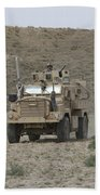 A U.s. Army Cougar Patrols A Wadi Beach Sheet