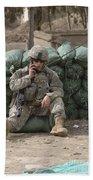 A U.s. Army Soldier Talks On A Radio Beach Towel