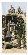 A U.s. Marine Dressed In A Bomb Suit Beach Sheet