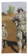 A Young Boy Joins His Squad Leader Beach Towel