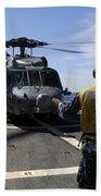 Airman Signals To An Mh-60s Sea Hawk Beach Towel