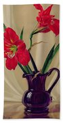 Amaryllis Lillies In A Dark Glass Jug Beach Towel