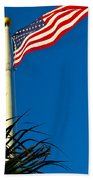American Flag Flying Over The Palms Beach Towel