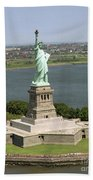 An Aerial View Of The Statue Of Liberty Beach Towel