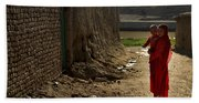 An Afghan Girl Carries Her Little Beach Towel
