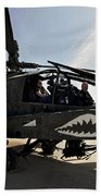 An Ah-64d Apache Helicopter Parked Beach Towel