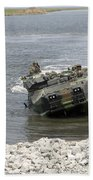 An Amphibious Assault Vehicle Climbs Beach Towel