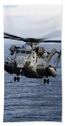 An Mh-53e Sea Dragon In Flight Beach Towel