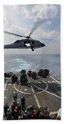 An Mh-60r Sea Hawk Transfers Supplies Beach Towel