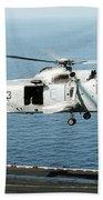 An Sh-3h Sea King Helicopter Prepares Beach Towel