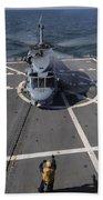 An Sh-60b Sea Hawk Lands On The Flight Beach Sheet