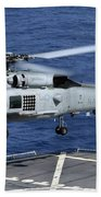 An Sh-60b Seahawk Helicopter Performs Beach Towel