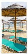 Beach Umbrellas On Sandy Seashore Beach Towel by Elena Elisseeva
