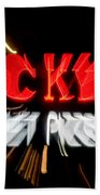 Blurred Neon Sign Beach Towel