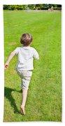 Boy Running Beach Towel