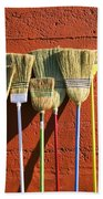 Brooms Leaning Against Wall Beach Towel