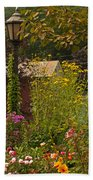 By The Light Of The Garden Beach Towel