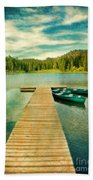 Canoes At The End Of The Dock Beach Towel
