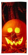 Carved Pumpkin With Fall Leaves Beach Towel