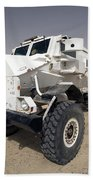 Casper Armored Vehicle Sits Beach Towel