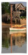 Catboat And Rippled Water Reflections Beach Towel