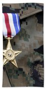 Close-up Of A Medal On The Uniform Beach Towel