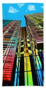 Colors In The City With Clouds Beach Towel