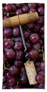 Corkscrew And Wine Cork On Red Grapes Beach Towel