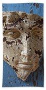Cracked Face On Blue Wall Beach Towel