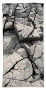 Cracked Rocks On Shore Beach Towel