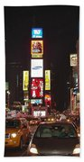 Crossing The Street At Times Square At Night Beach Towel
