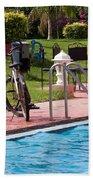 Cycle Near A Swimming Pool And Greenery Beach Towel