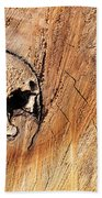 Face In The Wood Beach Towel