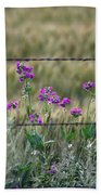 Fence And Flowers Beach Towel