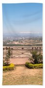 Fence And Garden Overlooking A Beautiful Vista Of Valley And Snow-capped Mountains Beach Towel