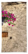 Flowers And A Signboard Beach Towel