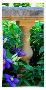 Garden Wall With Periwinkle Flowers Beach Towel